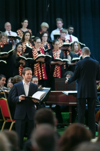 Countertenor Benjamin Williamson performing with Qatar Concert Choir