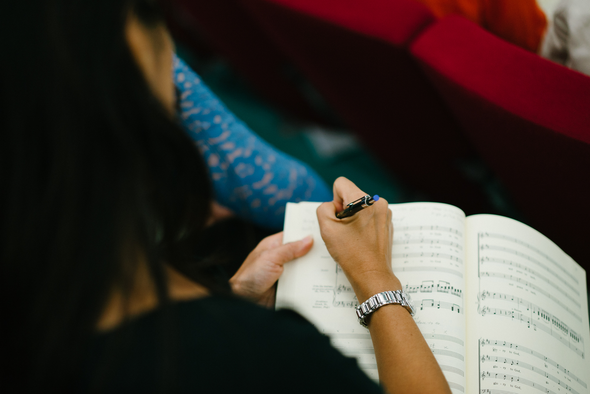 Taking notes during Qatar Concert Choir rehearsal